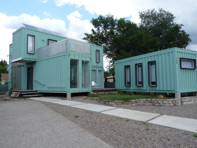 Turquoise blue shipping containers turned into a modular house