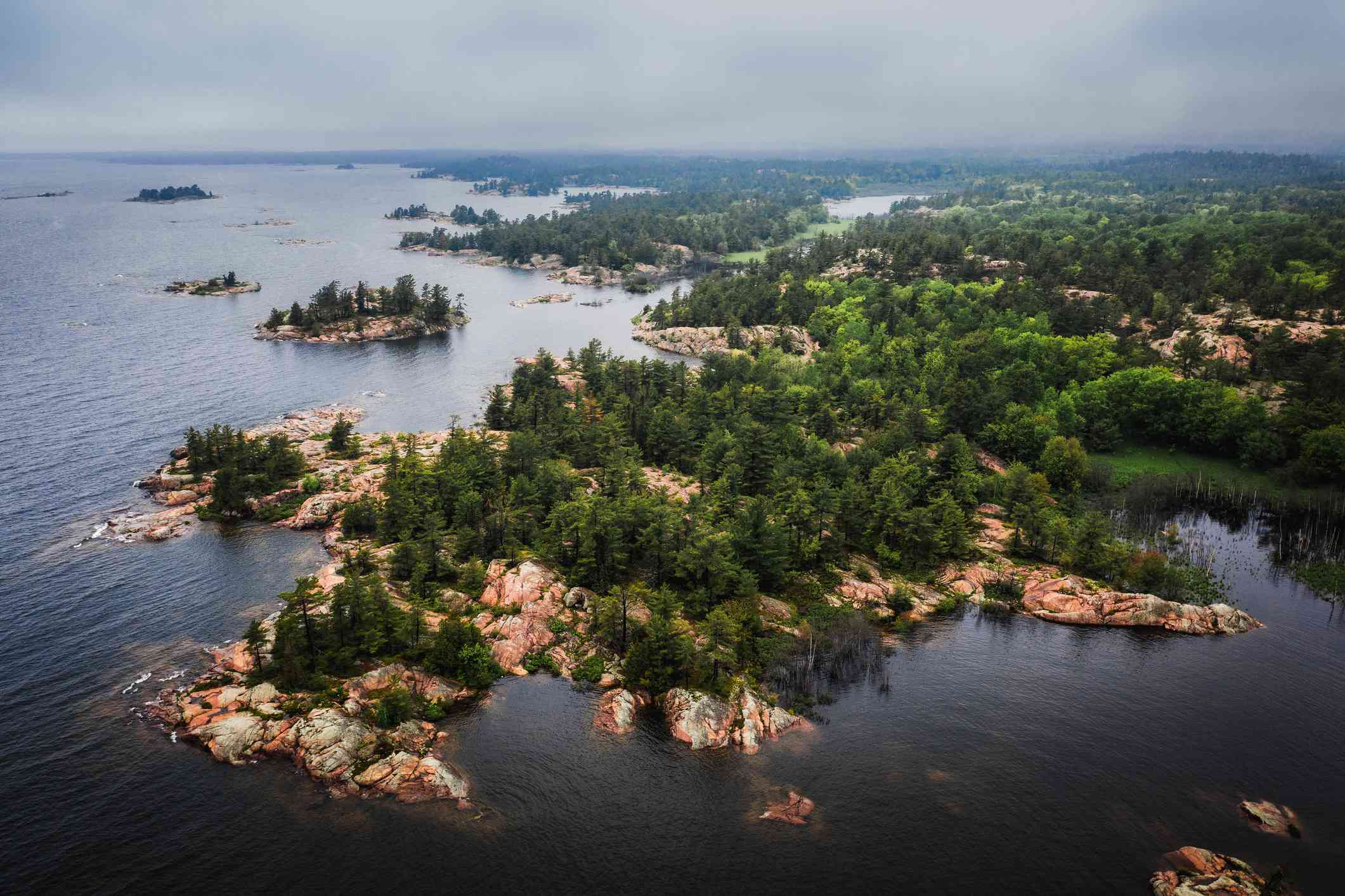 Aerial view of tree-topped rocky islands in Lake Huron