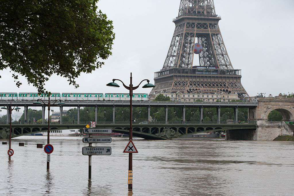 As the rain-swollen River Seine floods its banks, many Paris institutions including the Louvre, are forced to shutter their doors.