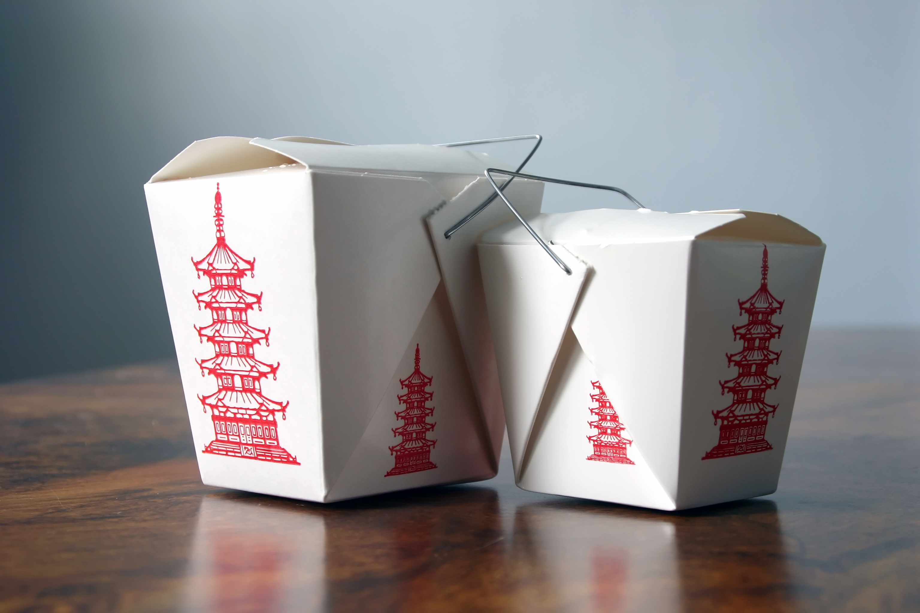 Two Chinese food takeout pail boxes.