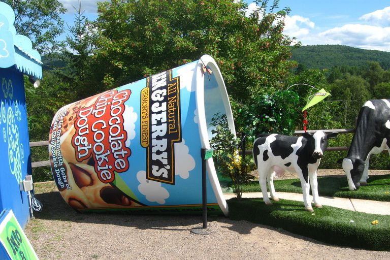 Scuplture of a tipped over carton of Ben & Jerry's ice cream with a sculpture of a cow