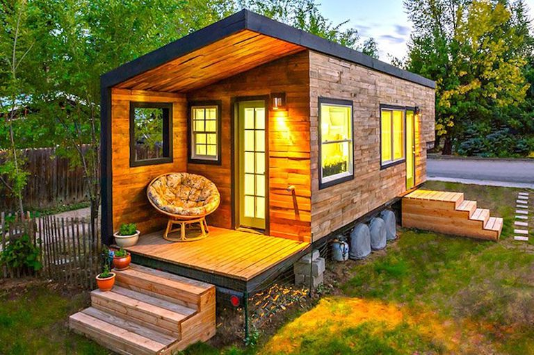 Exterior of tiny house with steps leading up to a front porch