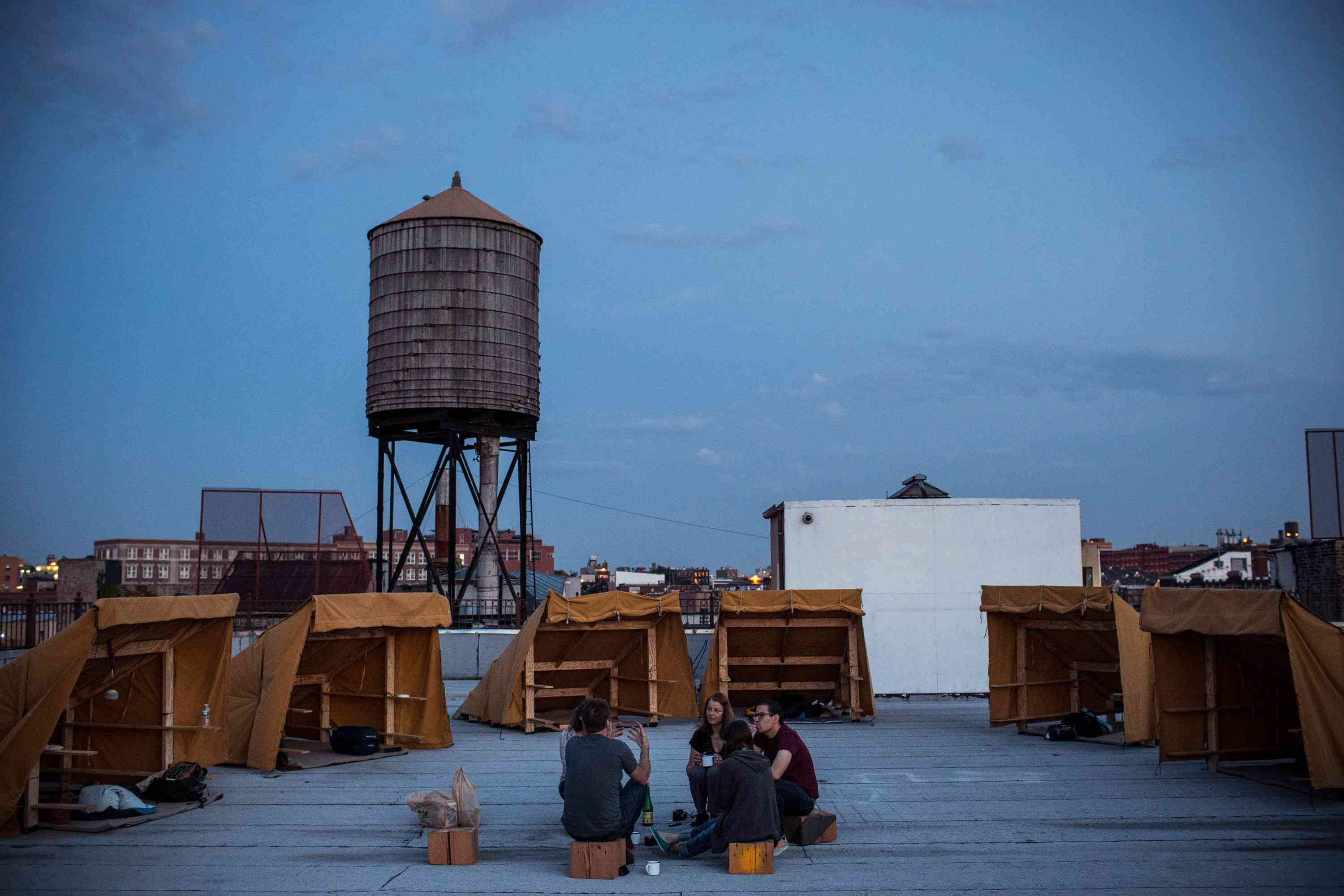 A group of people camp on a roof of New York City with Thomas Stevenson