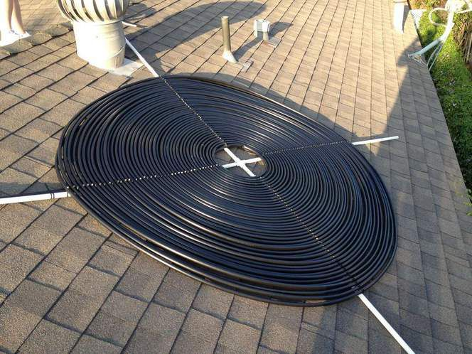 Large coil of wire on a brick walkway