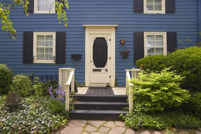 Traditional North American home with shrubs in front of house
