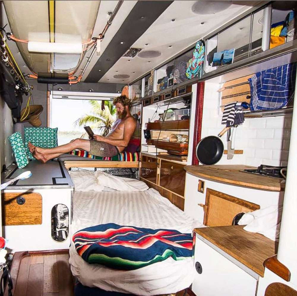Interior view of ambulance RV with man relaxing in the back