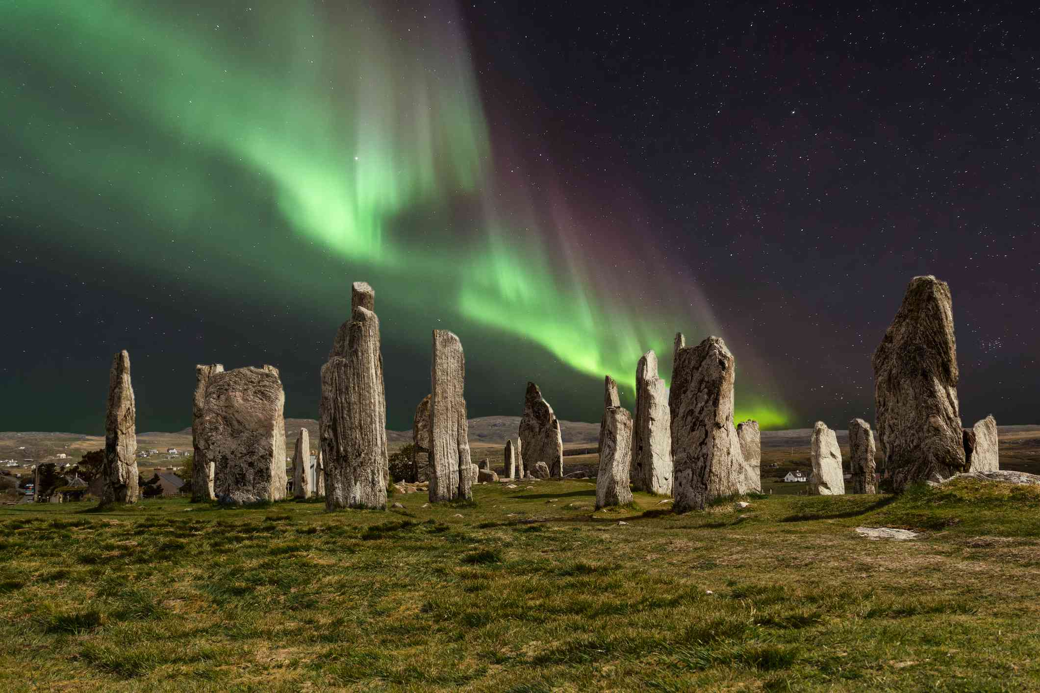 Northern lights over ancient stone formation in Callanish, Scotland