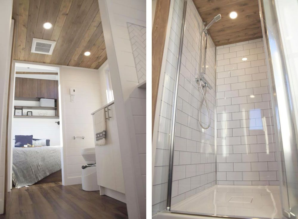 Bathroom showing toilet, sink, and shower