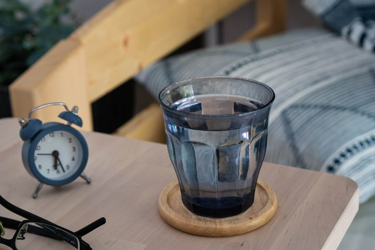 glass of water near bedside table