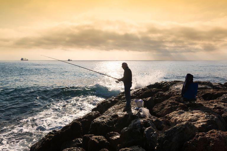 A fisherman fishing at dawn
