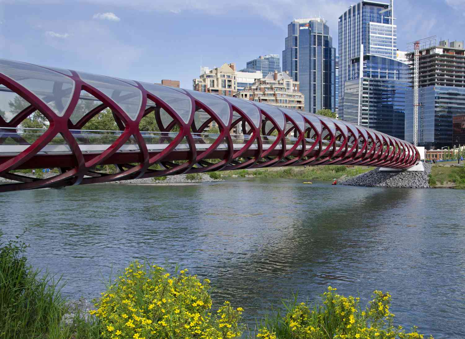 The red, helical Peace Bridge in Calgary on a sunny day