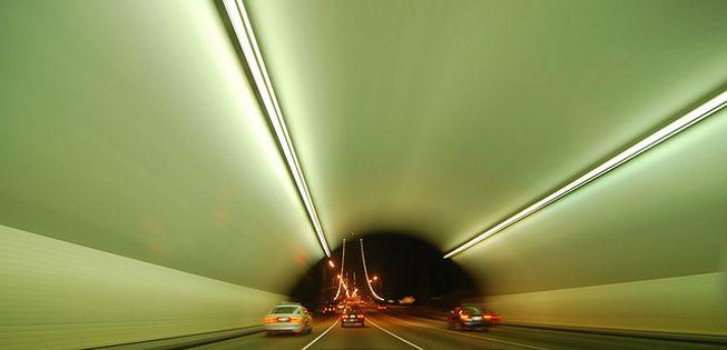 Cars pass through the Yerba Buena Island Tunnel in San Francisco at night