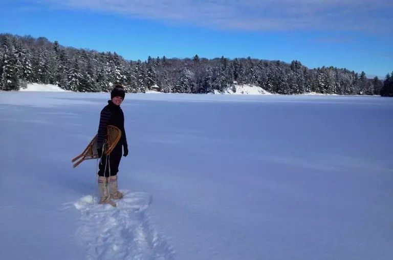 Katherine snowshoeing on frozen lake