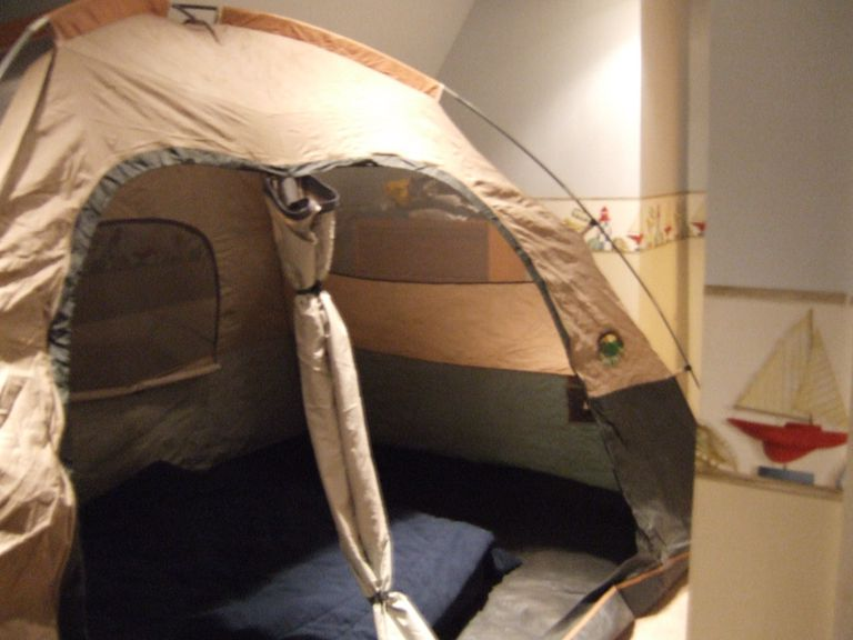 Camping tent erected in a bedroom