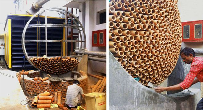 Workers building with terracotta tubes