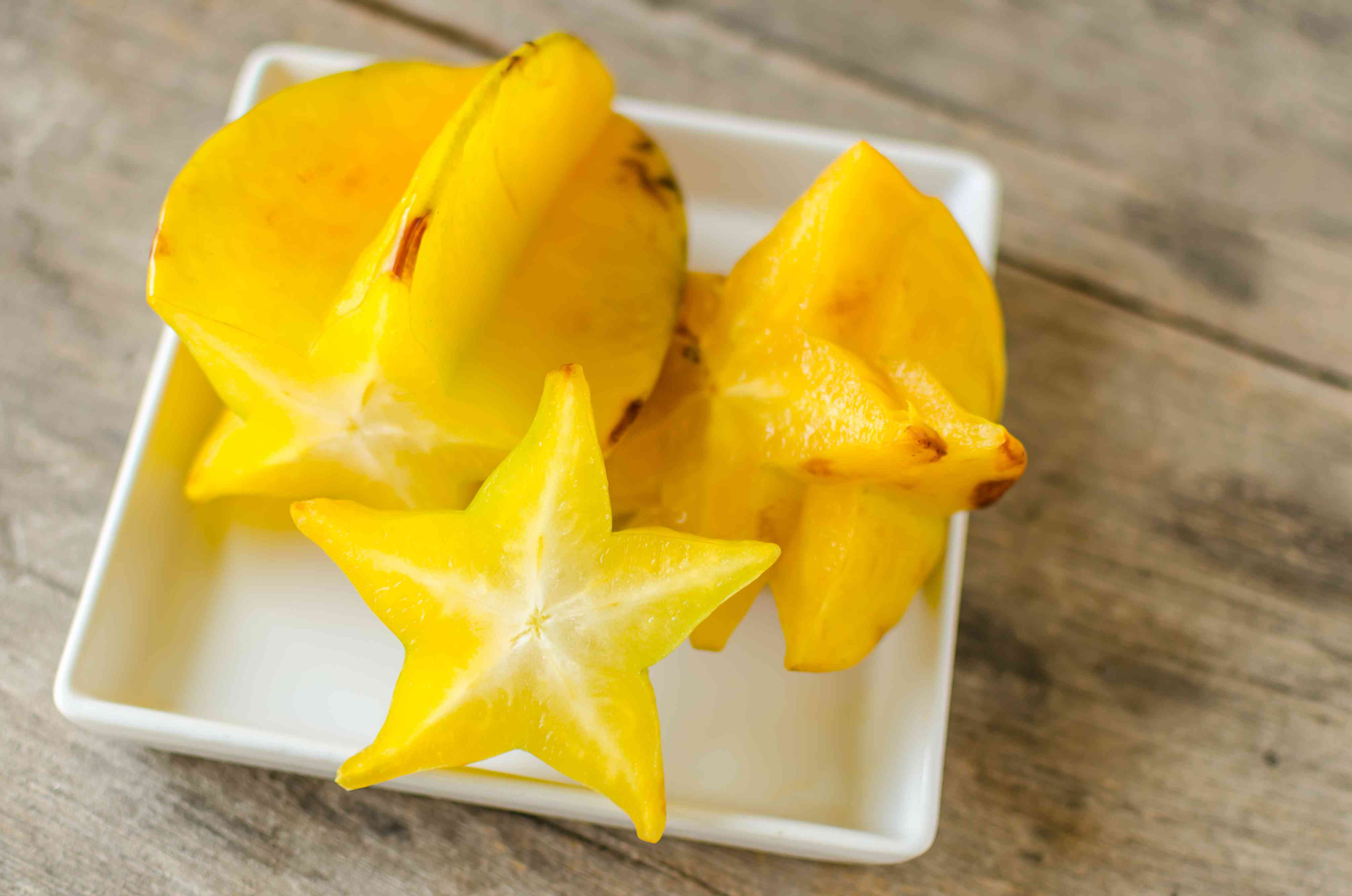 Close-Up Of Starfruit In Bowl On Table