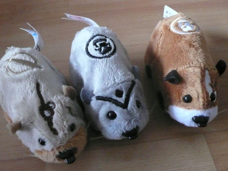 Three stuffed animal brown and white Zhu Zhu Pets.