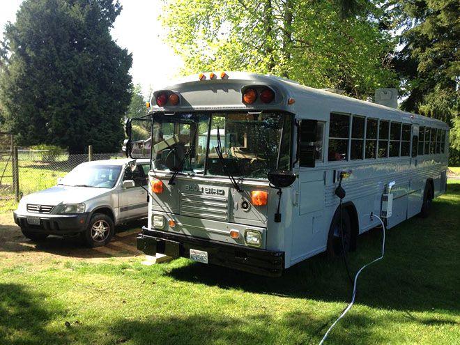 Exterior of white renovated school bus