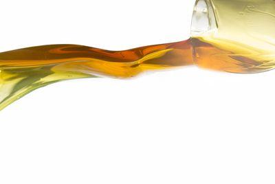 Active oil splash in white background
