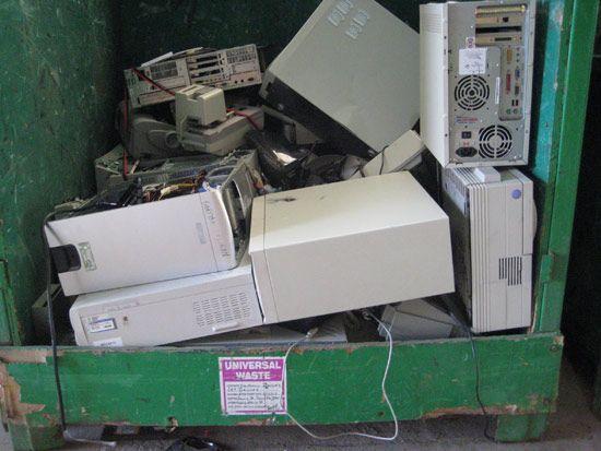 Computer electronic waste in a green bin.