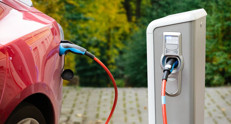 Close up of a charging electric car.