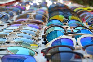 Sunglasses displayed on market table