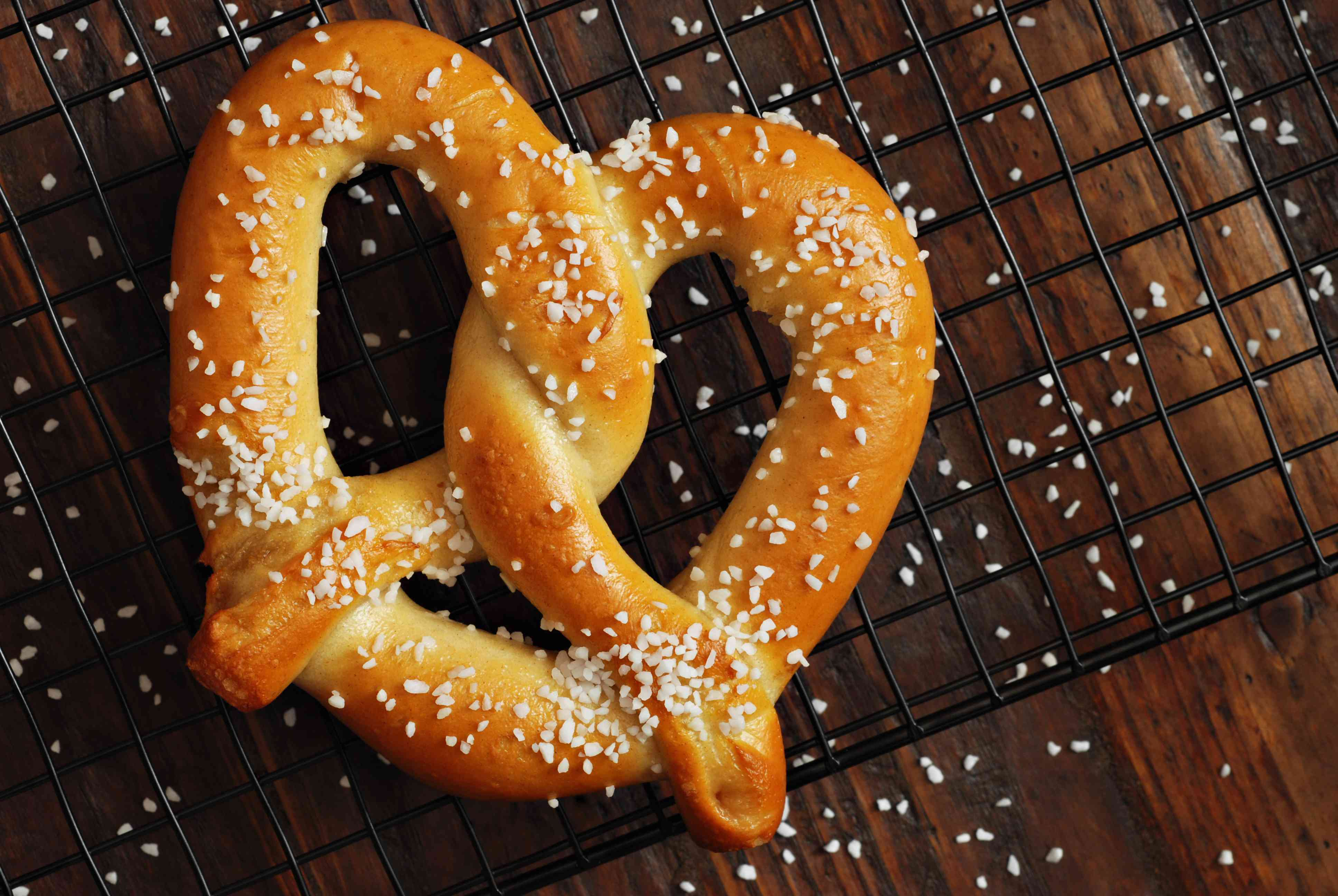 Baked soft pretzel on a cooling rack