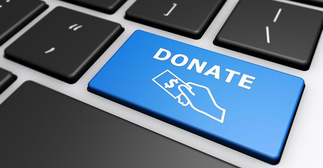 A blue keyboard button with the word DONATE on it
