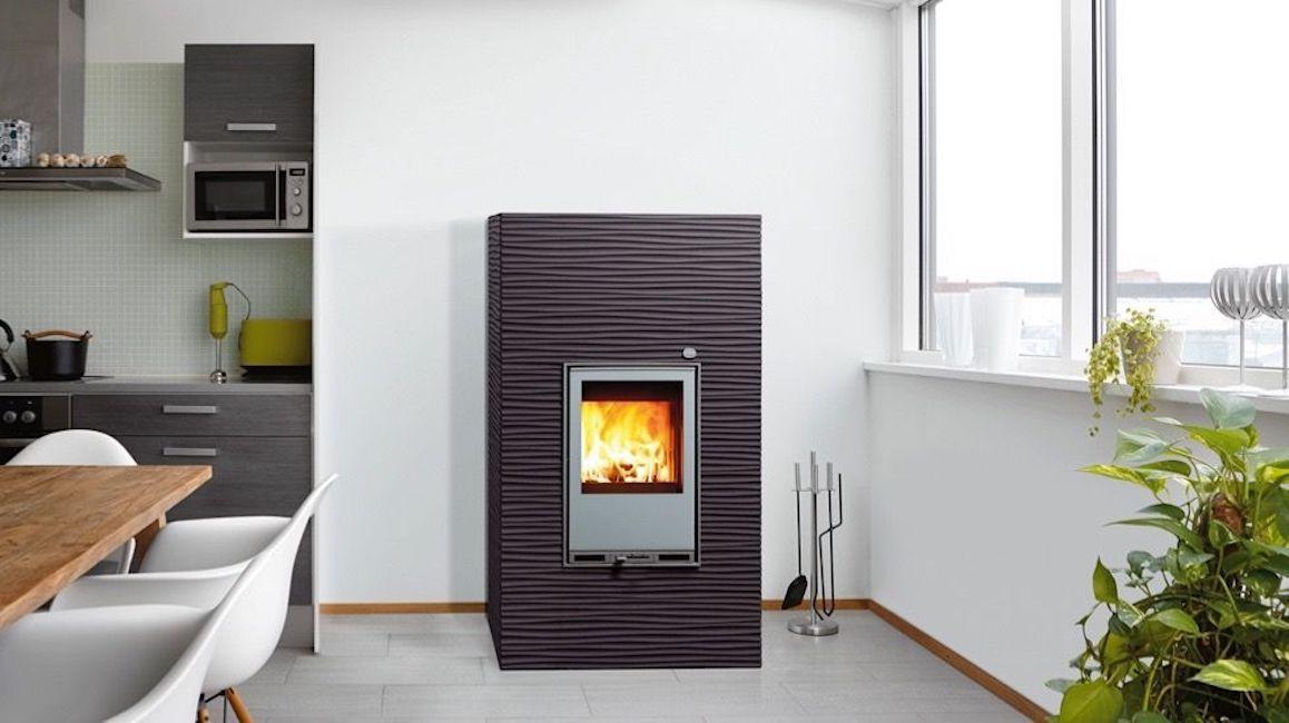 Gray rectangular pellet stove against a white wall
