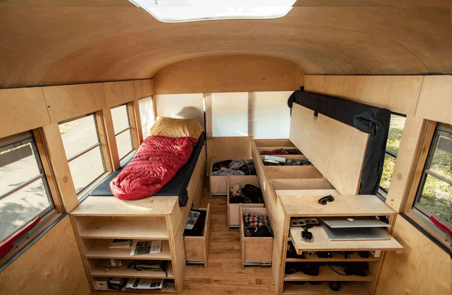 Bedroom area of school bus tuned into a tiny house
