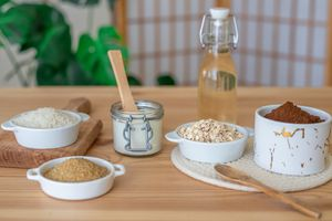 variety of foods used for natural exfoliation including oats, sugar, salt all in containers on table