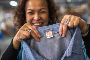 Woman holding shirt with toad & co label