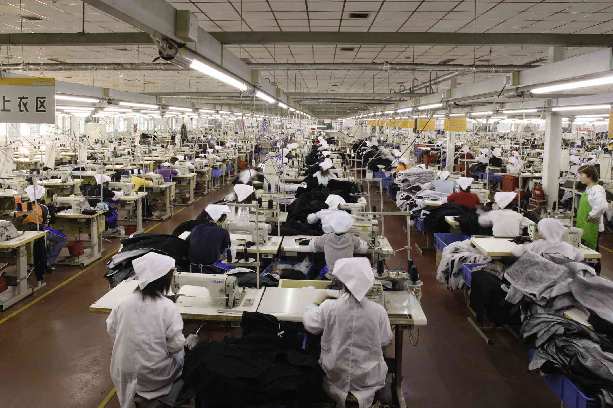 Workers at sewing machines in a factory