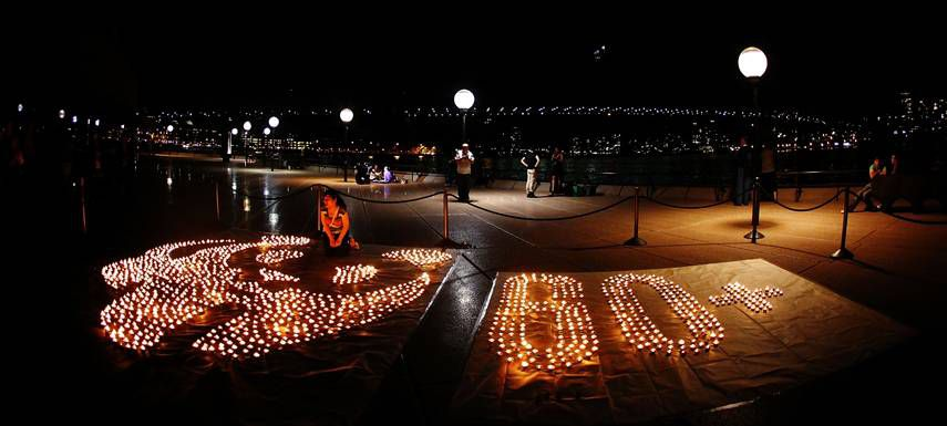 A candle mural depicting the World Wildlife Fund panda and the Earth Hour logo is lit on the forecourt of the Sydney Opera House as the lights are switched off for Earth Hour on March 31 in Sydney, Australia.