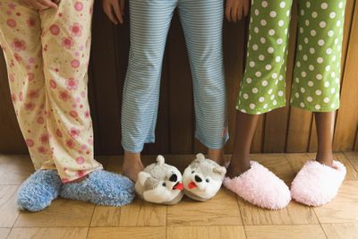 Wearing pajamas and slippers