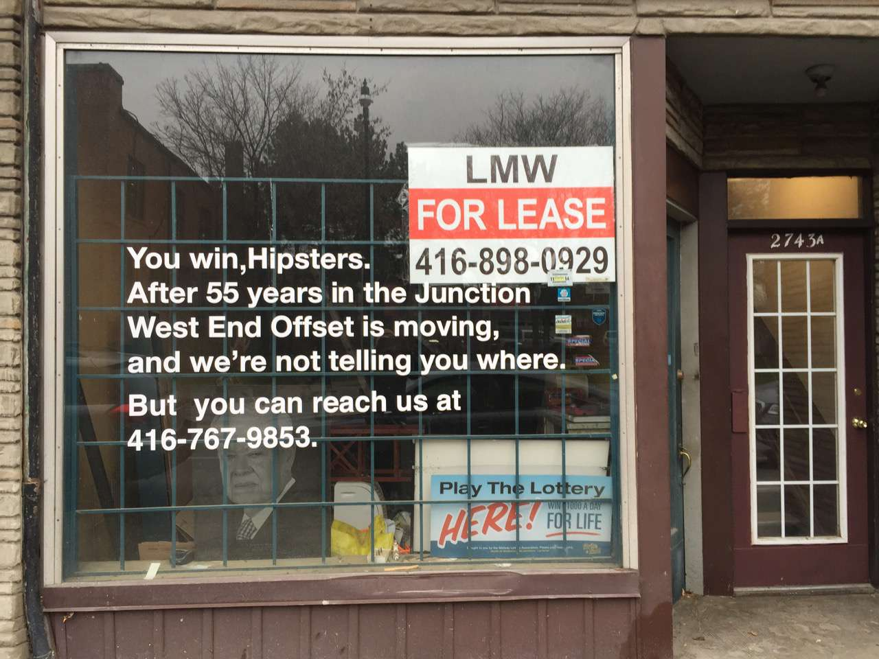 sign in store window