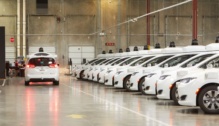 Waymo autonomous cars lined up and ready to roll