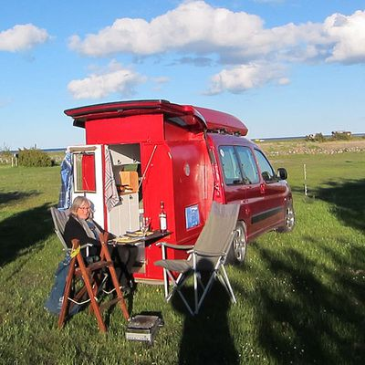 The converted camper van fully extended and parked in the grass
