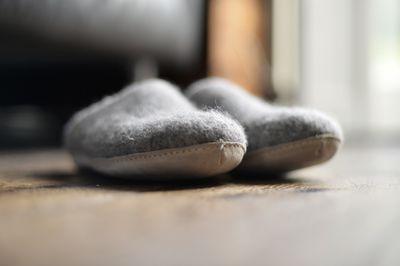A pair of Grey wool felt slippers
