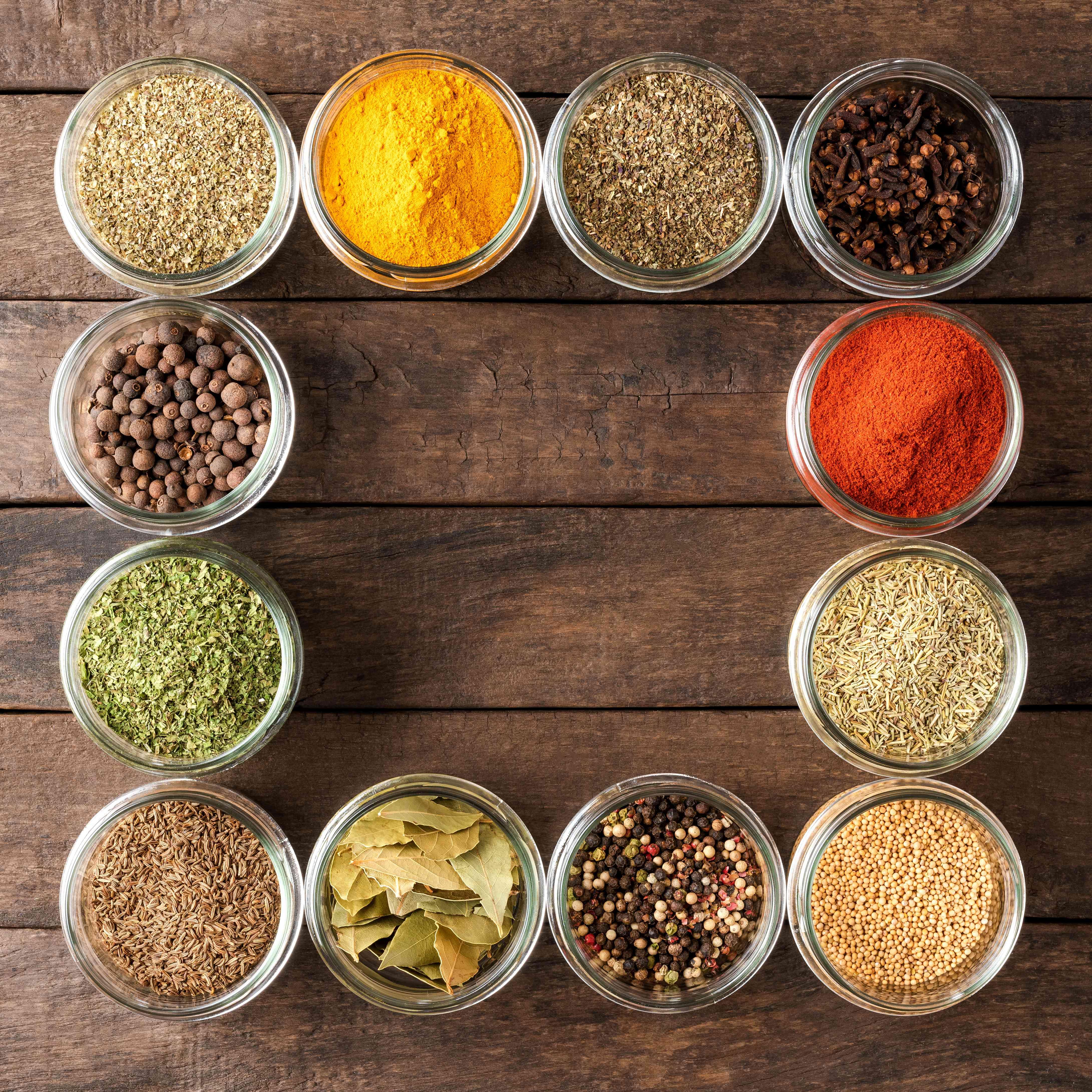 Various types of seasonings in bowls, create a pantry