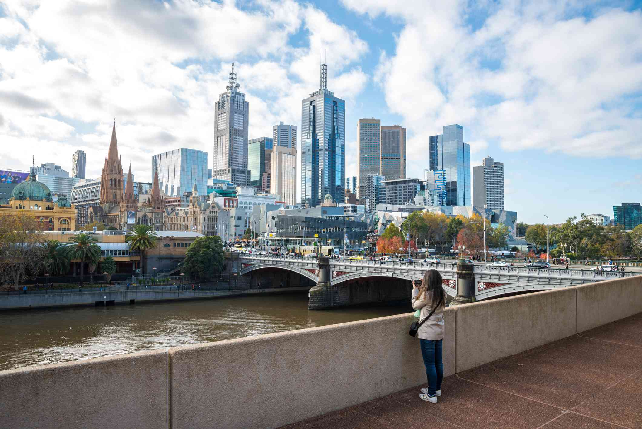 Tourists take pictures of downtown Melbourne from viewpoint