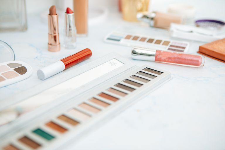 Make up open and spread out on a white table.
