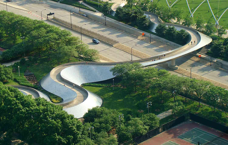 The winding BP Pedestrian Bridge crosses over a highway in Chicago