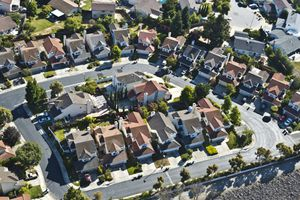 A cul de sac of two-story suburban tract homes in Southern California.