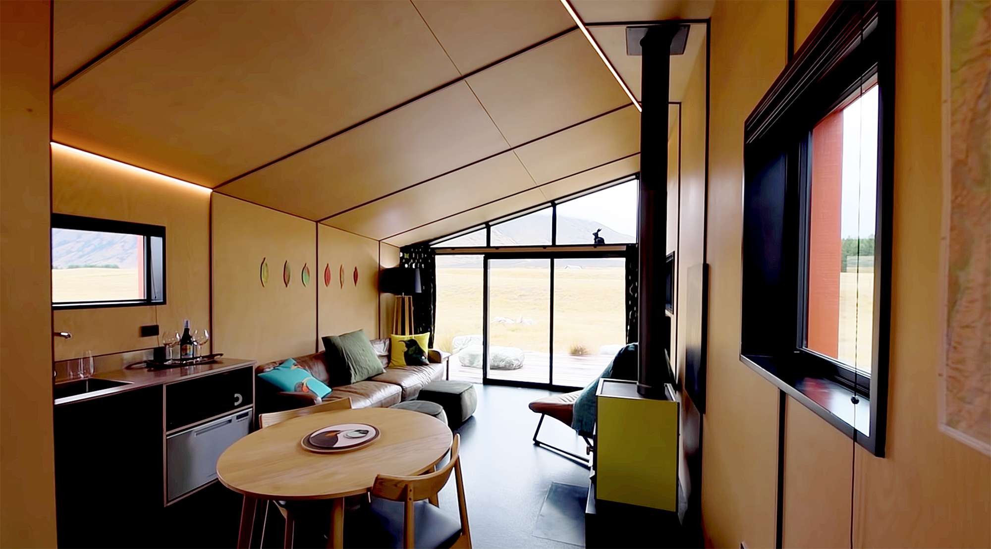 Skylark Cabin by Barry Connor Living Big In A Tiny HouseSkylark Cabin by Barry Connor Living Big In A Tiny HouseSkylark Cabin by Barry Connor living room and kitchen