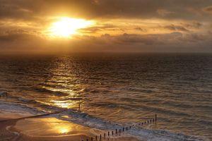 Cloudy sunrise above Southbourne Beach along southern coast of England