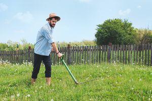 cutting grass with a scythe