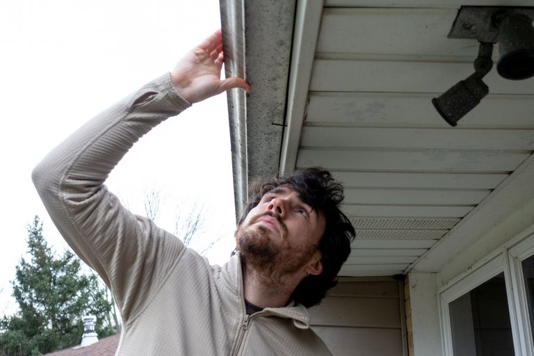 how to inspect for mold man with gutter