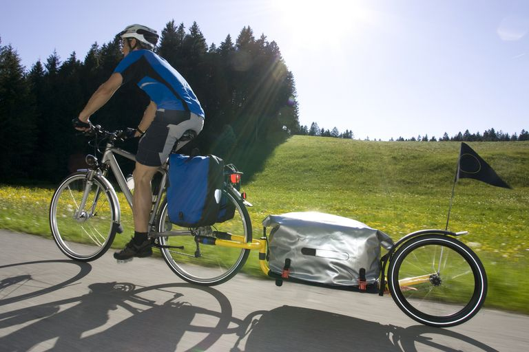 Man riding a mountain bike with a trailer