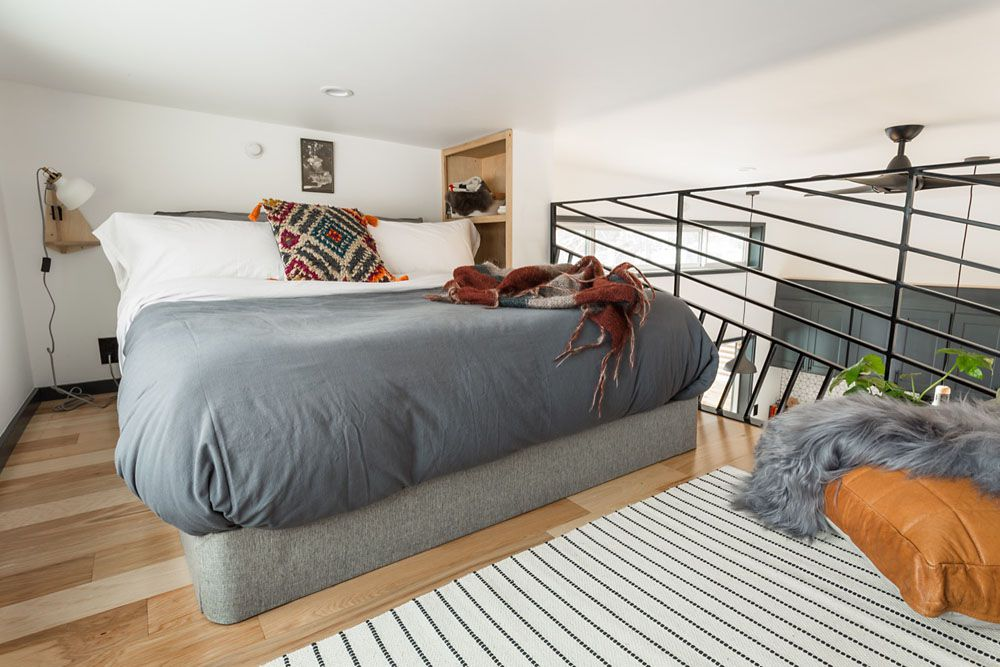 Sleeping loft with bed in the tiny home